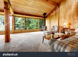 living room with vaulted ceiling spacious log cabin living room high stock photo 198322286