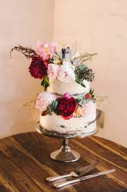 simple two tiered wedding cake with fresh flowers nouba com au
