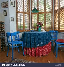 bright blue painted chairs at table with red and blue cloths in