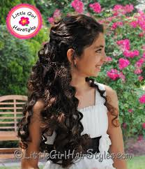 pageant style curling long hair beautiful barrette hairstyle with curls perfect for parties