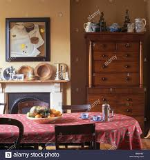 Pink Patterned Cloth On Table In Small Dining Room With Tall - Dining room chests