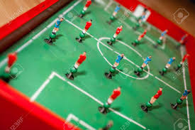 table top football games close up shot of red and blue players of a tabletop football stock