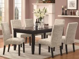 fancy dining room with upholstered dining chair also wood dining