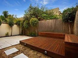 small backyard deck designs with planters and bench great small