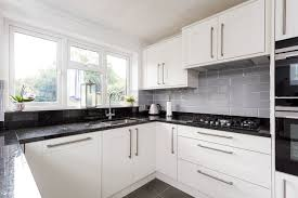 broadoak shaker kitchen in chalk with nero assoluto black granite design supply and installation of quality kitchens our ranges are nolte kitchens and 1909 kitchens call us on 0208 363 enfield and cheshunt showrooms