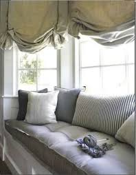 window treatments for bay windows green curtains and roman shades