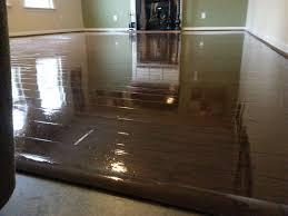 sleek design of painted hardwood floors in dark brown paint color