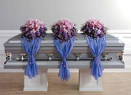 floral arrangements for funeral casket sprays and accompanying arrangements for the family