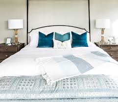 smi modern farmhouse master bedroom and bathroom sita montgomery the white bedding is the perfect backdrop for some gorgeous velvet pillows in deep blue tones