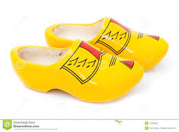 holland traditional yellow wooden shoes stock photos images
