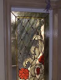 hand crafted stained glass with hand painted kiln fired corner