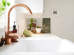 copper faucets kitchen crisp white home with pops of foliage glitter inc glitter inc