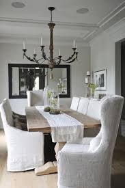 Linen Slipcovered Dining Chairs Dining Room Farm Table And Slipcovered Chairs And Terrarium