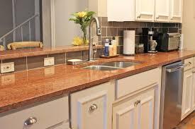 Granite Countertops With White Kitchen Cabinets by Kitchen Design With Terra Cotta Red Granite Countertops White