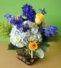 white flower arrangements blue and yellow flower arrangements eatatjacknjills