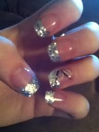 silver glitter acrylic nails with middle finger design