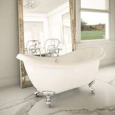 small upholstered stool beside roll top bath in a traditional