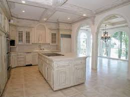 traditional kitchen with kitchen island raised panel zillow traditional kitchen with columns crown molding glass panel limestone tile floors kensington