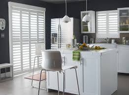 polysatin shutters featuring a bifold tracking system in white