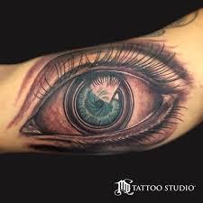 md tattoo studio camera lens eye tattoo