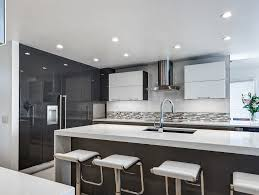 modern kitchens pinterest high gloss cabinetry white quartz countertops waterfall edges