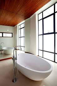 Minimalist Home Design Interior Minimalist Home Designs Deluxe Bathtub Design In White Color At