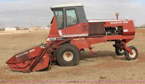 1982 hesston 6650 self propelled swather item h8326 sold