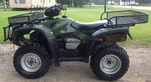 2005 honda foreman 500 4x4 4 wheeler with an extra set of