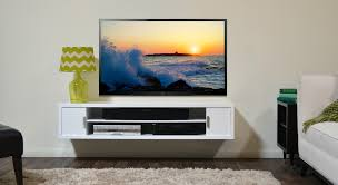 white wooden wall mounted entertainment center with racks and