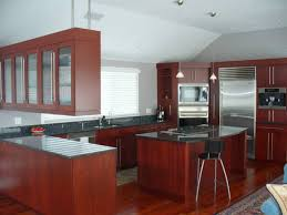 Full Overlay Kitchen Cabinets Cherry Full Overlay Cabinets With Blue Pearl Countertops And
