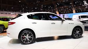 white maserati sedan white maserati levante italian luxury suv on display during the