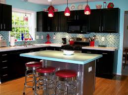 bright kitchen with black cabinet paint