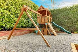 exterior backyard playground with swings climbing wood panel