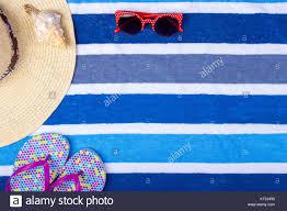 seashell flip flops straw woman s hat sun glasses top view seashell flip flops