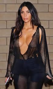 kim kardashian flaunts assets in mesh top daily mail online
