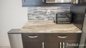 brown quartzite kitchen counter with dark cabinets