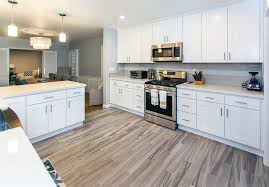 white shaker kitchen cabinets wood floors how white shaker cabinets improve your home value best