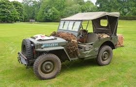 ww2 jeep world war 2 jeep with red cross banner parked on grass stock