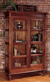 are curio cabinets out of style mahogany curio cabinet glass doors antique style furniture