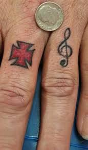 maltese cross and musical note tattooimages biz