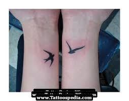 bird on wrist tattoomagz