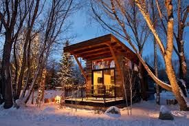 12 tiny house hotels to try out micro living curbed a tiny home surrounded by snow in jackson hole wyoming