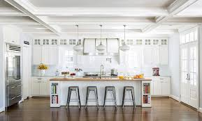 long butcher block top island with tolix stools transitional