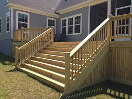 curved black balusters and a varied width deck skirt smarten up