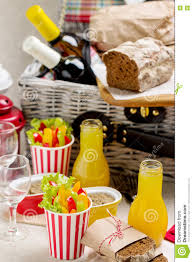 table setting for a summer picnic picnic basket with food wine