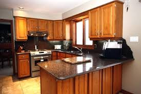 countertops with oak cabinet example of a classic kitchen design