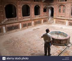 an architect admires the design on an old haveli merchants home