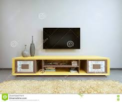 Yellow Livingroom by Tv Unit In Living Room With Yellow Tv On The Wall Stock