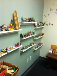 storage for sandtray miniatures in the office of play therapist