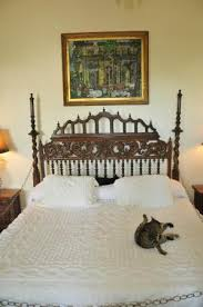 bed in master bedroom headboard was actually a gate from spain